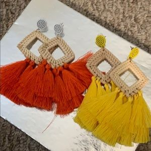 Never worn feather earrings!